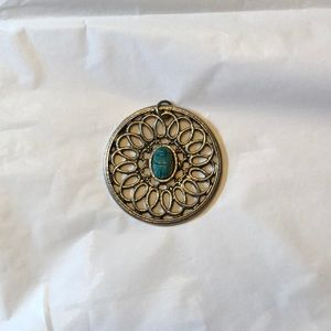 Round silver pendant, with blue stone center